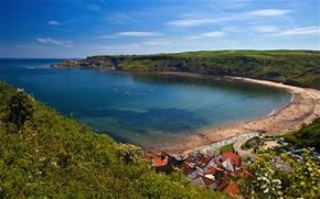 The quiet coastal village of Runswick Bay where a sheltered beach and excellent coastal walks back onto the North York Moors National Park. The beach is just a 10-15 minute walk from the park